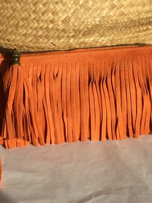 Orange suede fringe clutch bag
